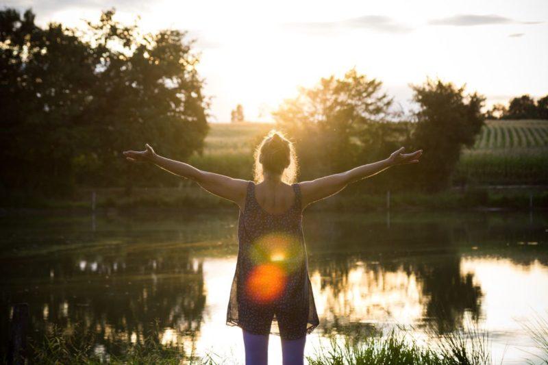 woman embracing the sunrise